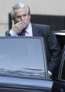 Spanish High Court judge Baltasar Garzon gestures as he leaves the High Court in Madrid
