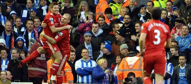 Los jugadores del Liverpool celebran uno de los goles ante el Brighton.