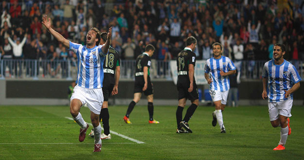 Malaga's Van Nistelrooy celebrates after scoring a goal against Racing Santander during their Spanish First Division soccer match in Malaga
