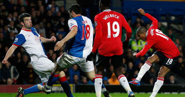 Manchester United's Young scores against Blackburn Rovers during their English Premier League soccer match in Blackburn