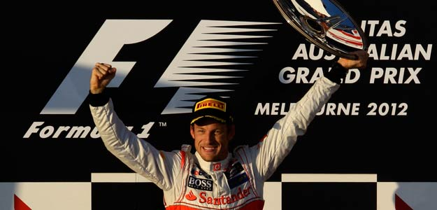 McLaren Formula One driver Button celebrates his victory on the podium after the Australian F1 Grand Prix at the Albert Park circuit in Melbourne