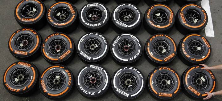 A mechanic arranges Pirelli tyres in the paddock ahead of the Spanish F1 Grand Prix in Montmelo