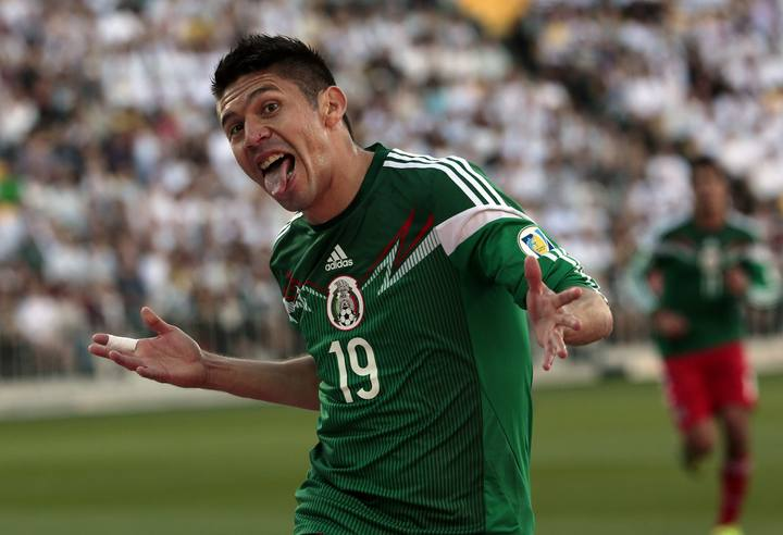 Mexico's Peralta celebrates after scoring a goal against New Zealand during their 2014 World Cup qualifying playoff second leg soccer match in Wellington