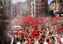Revellers hold up traditonal red scarves at the start of the San Fermin festival in Pamplona.