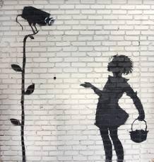 """Mural de Banksy titulado """"Florista (Muchacha con una flor)"""" pintado en la pared de una gasolinera de Los Angeles. Será subastado en diciembre en Beverly Hills."""
