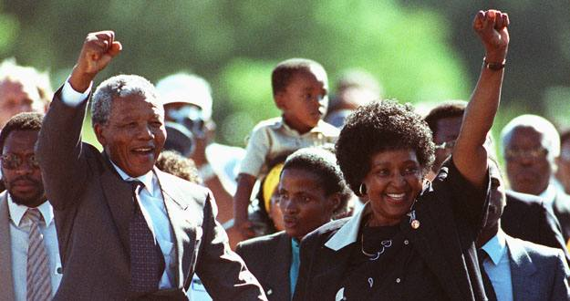 Black nationalist leader Nelson Mandela and his wife Winnie salute well-wishers as he leaves Victor ..