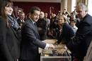 Nicolas Sarkozy, France&#146;s President and UMP party candidate for his re-election, votes in the second round of the presidential elections with his wife Carla Bruni-Sarkozy in Paris
