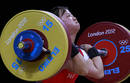 North Korea's Chun Hwa Ryang competes on the women 48Kg Group A weightlifting competition at the London 2012 Olympic Games