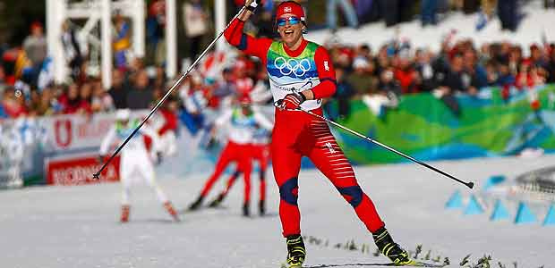 Norway's Bjoergen crosses the finish line win women's 15 km pursuit cross-country final at the Vancouver 2010 Winter Olympics in Whistler