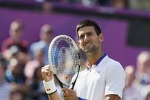 Novak Djokovic celebra un punto en su partido contra el francés Tsonga