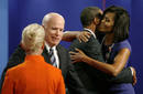 Obama and McCain greet their wives onstage as they conclude their presidential debate at Hofstra University in Hempstead, New York