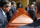 Pallbearers carry coffin with the body of Mexican novelist Fuentes out from his home in Mexico City