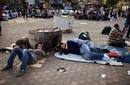 People sleep during a sit-in at Tahrir Square, after a court sentenced deposed president Mubarak to life in prison, in Cairo
