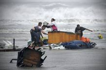 People try to recover things that are being washed away by flood in Boca Del Rio on outskirts of Veracruz