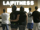 People wait behind police lines outside the LA Fitness gym in Bridgeville