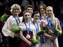 Medallists stand together after the ice dance figure skating event at the Vancouver Winter Olympics