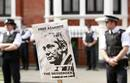 Police and protesters wait for Wikileaks founder Julian Assange to speak to the media outside the Ecuador embassy in west London