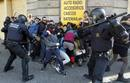 Police disperse demonstrators during protests against spending cuts in public education in Barcelona