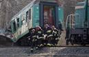 Polish emergency services workers carry the body of a victim of a train crash near the town of Szczekociny