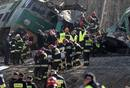 Polish emergency services workers remove the body of the 16th victim of a train crash near the town of Szczekociny