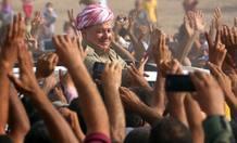 Iraqi Kurdish President Barzani visits Syrian refugees at the Quru Gusik refugee camp in Arbil
