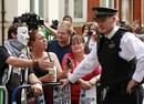 Protesters try to negotiate with police as they wait for Wikileaks founder Julian Assange to speak to the media outside the Ecuador embassy in west London