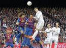 Real Madrid's Cristiano Ronaldo heads tha ball next to Barcelona's Puyol and Alcantara during their Spanish first division soccer match in Barcelona