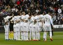 Real Madrid players hold a minute of silence for Livorno's Piermario Morosini before their Spanish First Division soccer match and Sporting Gijon in Madrid