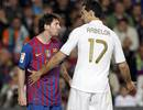 Barcelona's Messi argues with Real Madrid's Arbeloa during their Spanish first division