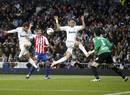 Real Madrid's Higuain scores a goal in front of his teammate Pepe and Sporting Gijon's Hernandez and goalkeeper Colinas during their Spanish First Division soccer match in Madrid