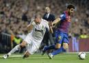Real Madrid's Pepe falls next to Barcelona's Fabregas during their Spanish King's Cup soccer match in Madrid