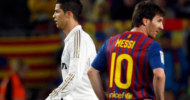 "Real Madrid's Ronaldo walks past Barcelona's Messi after scoring his goal during their Spanish first division ""El Clasico"" soccer match"