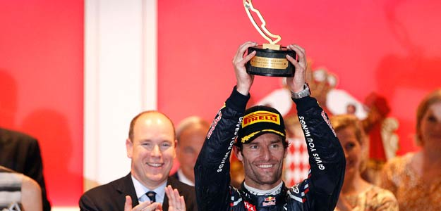 Red Bull Formula One driver Webber of Australia celebrates on the podium after winning the Monaco F1 Grand Prix