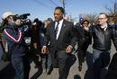 Reverend Jesse Jackson walks to the New Hope Baptist Church for the funeral service for the late singer Whitney Houston in Newark