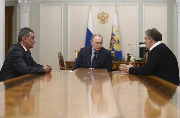 Russian President Putin meets with former deputy commander of the Russian Black Sea Fleet Vice-Admiral Menyailo and Sevastopol head Chaliy at Novo-Ogaryovo state residence outside Moscow