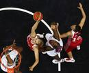Russia's Natalya Vieru and Natalya Zhedik battle for the basket against France's Isabelle Yacoubou and Sandrine Gruda during their women's preliminary round Group B basketball match at the Basketball Arena during the London 2012 Olympic Games