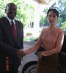 United Nations envoy Ibrahim Gambari shakes hands with Aung San Suu Kyi