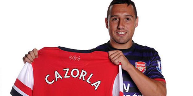 Santi Cazorla posa con su nueva camiseta.