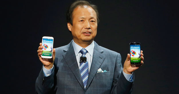 Shin, President and Head of IT and Mobile Communication Division, holds Galaxy S4 phone during its launch at the Radio City Music Hall in New York