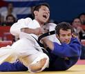 South Korea's Cho Jun-Ho fights with Spain's Sugoi Uriarte in their men's -66kg bronze medal B judo match at London 2012 Olympic Games