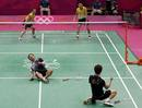 South Korea's Lee Yong-dae and Chung Jae-sung celebrate after winning their men's doubles badminton bronze medal match against Malaysia at the London 2012 Olympic Games at the Wembley Arena