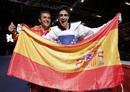 Spain's Joel Gonzalez Bonilla and his coach Francisco Martin Varela celebrate with a national flag after winning his men's -58kg gold medal taekwondo match against South Kor