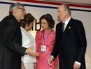 Spain's King Juan Carlos and Queen Sofia are greeted by Paraguay's President Fernando Lugo and first lady Mercedes Lugo as they arrive for the Latin American Summit of Paraguay in Asuncion