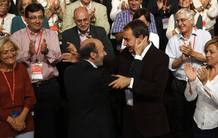 Spain's Socialist prime ministerial candidate Rubalcaba embraces Spanish PM Rodriguez Zapatero during the PSOE political conference in Madrid