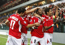 SStandard Liege's Dieudonne Mbokani celebrates after scoring against Olympiakos in Champions League soccer match in Liege