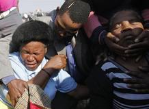 Familiares de los mineros asesinados acuden a los actos conmemorativos