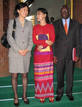 Suu Kyi poses with United Nations envoy Ibrahim Gambari and member of his team in Yangon