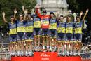 Team Saxo Bank rider Alberto Contador of Spain celebrates on the podium with his team after winning the Tour of Spain after the last stage of the 