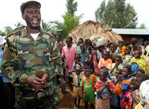 UPC REBEL LEADER THOMAS LUBANGA TALKS TO VILLAGERS ON HIS WAY TO A