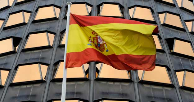 The Spanish flag flies in front of the Constitutional Tribunal in Madrid